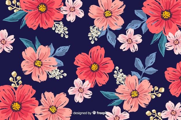 花の背景手描きのデザイン 無料ベクター