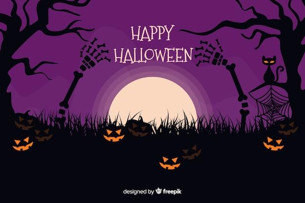 Хэллоуин фон с тыквами на фиолетовую ночь Бесплатные векторы