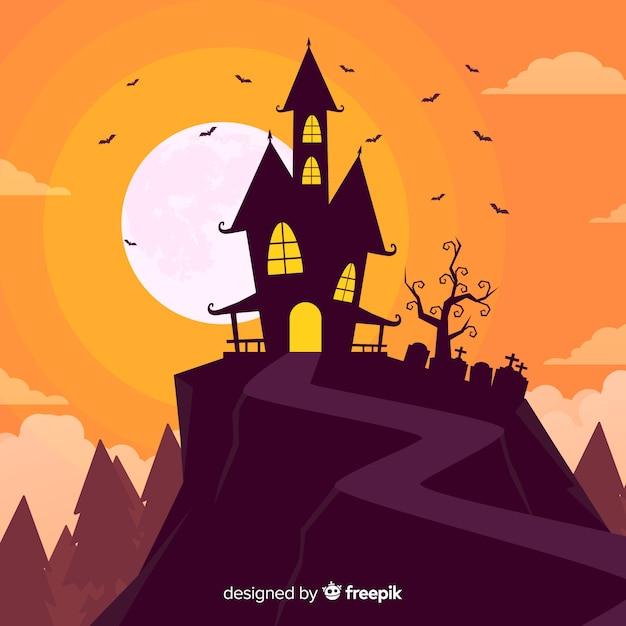 夕暮れのハロウィーンの背景の丘の上の家 無料ベクター