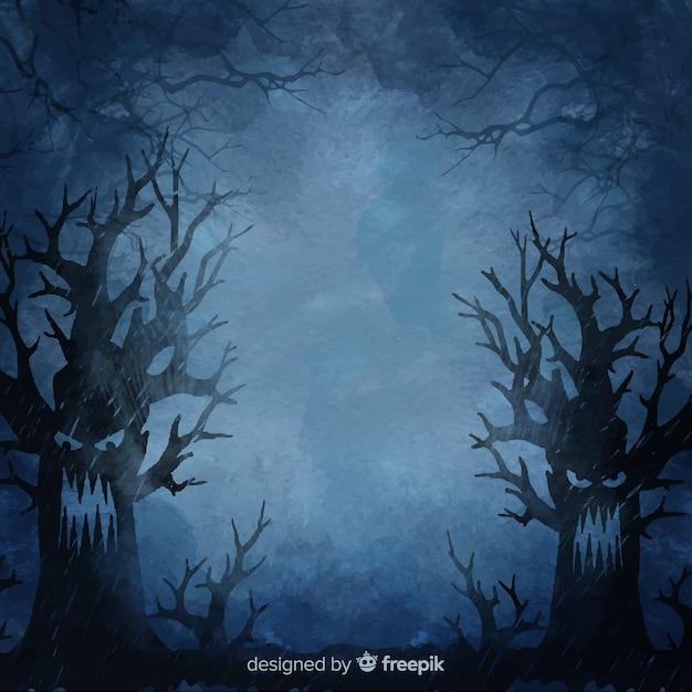 夜のハロウィーンの背景で怒っている木 無料ベクター