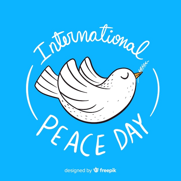 鳩と手描きの平和の日 無料ベクター