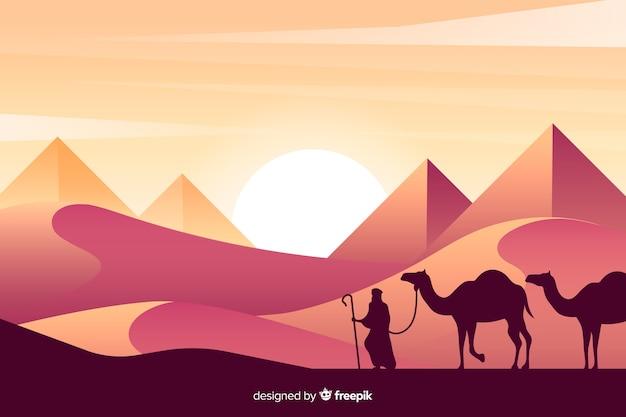 Силуэты человека и верблюдов в пустыне Бесплатные векторы