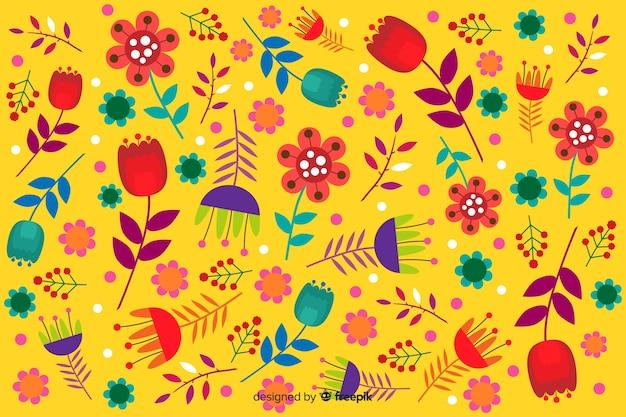 Желтый фон с цветочным узором Бесплатные векторы