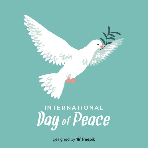 手描きの鳩の平和の日の概念 無料ベクター