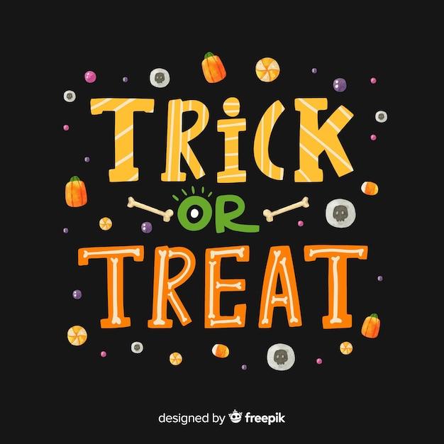 Черный трюк или угощение с конфетами Бесплатные векторы