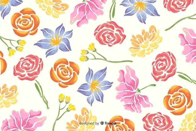 手描きの白い背景の上の花の背景 無料ベクター
