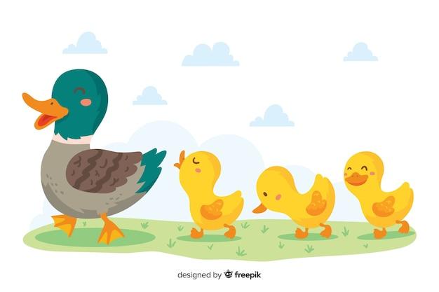 手描きの母鴨と歩いているアヒルの子 無料ベクター