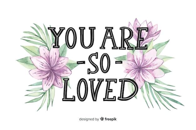花のあるポジティブなメッセージ:あなたはとても愛されています 無料ベクター