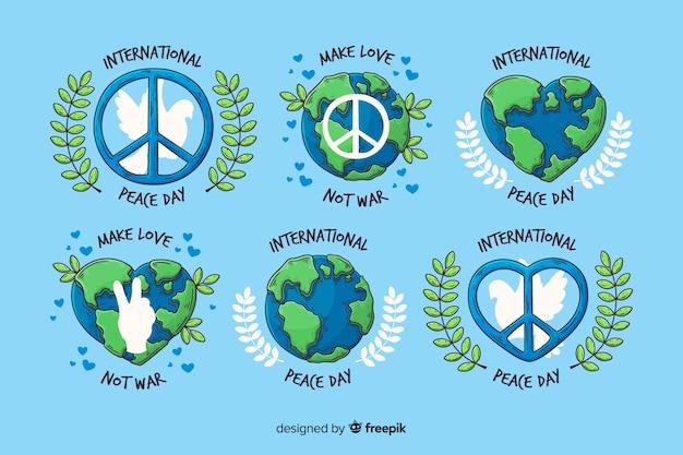 Нарисованная рукой коллекция значка дня мира Бесплатные векторы