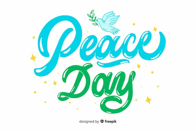 レタリングと平和の日の概念 無料ベクター