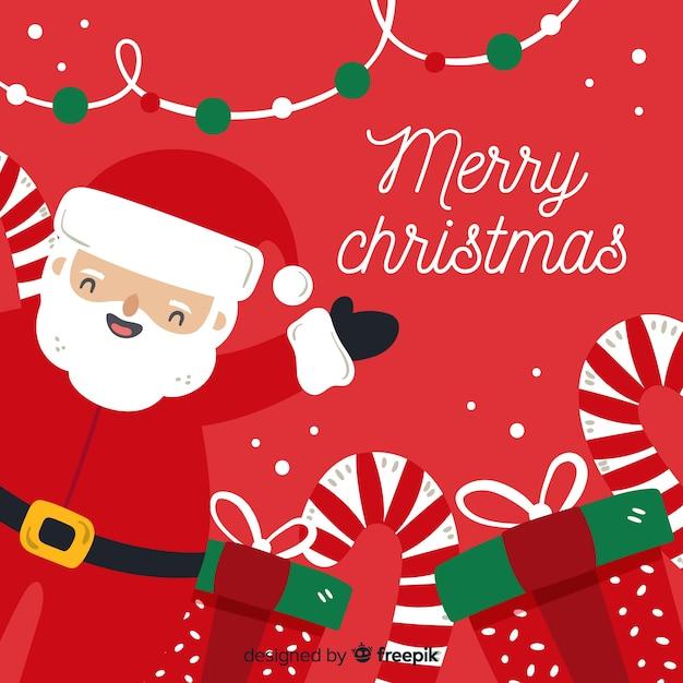 手描きのサンタクロースとクリスマスの背景 無料ベクター