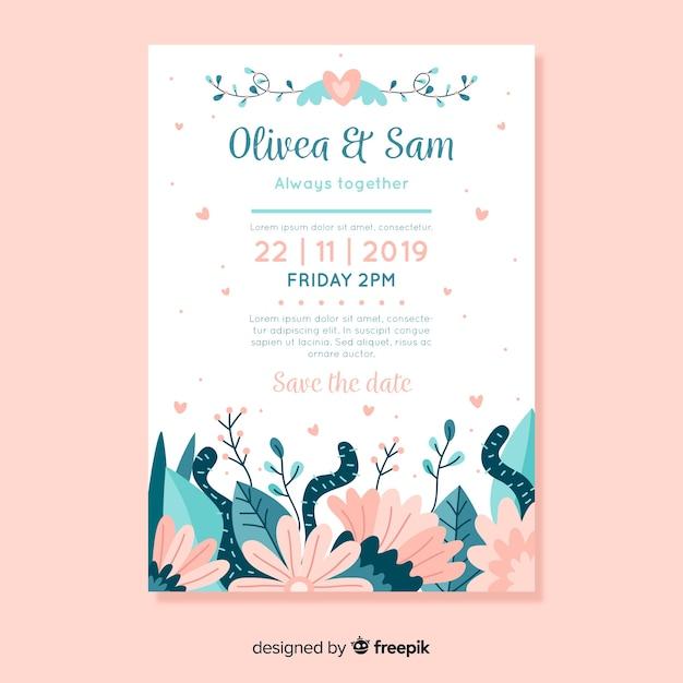 花を持つフラットなデザインの結婚式の招待状のテンプレート 無料ベクター