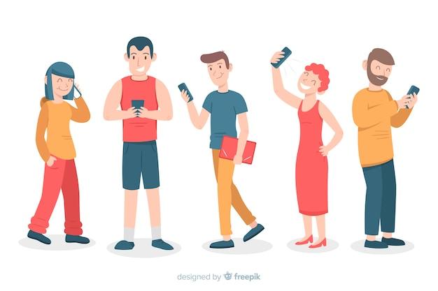 Молодые люди держат смартфоны Бесплатные векторы