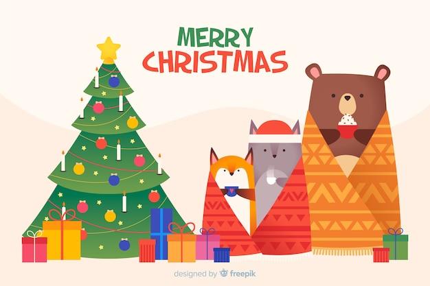 動物とフラットクリスマス背景 無料ベクター