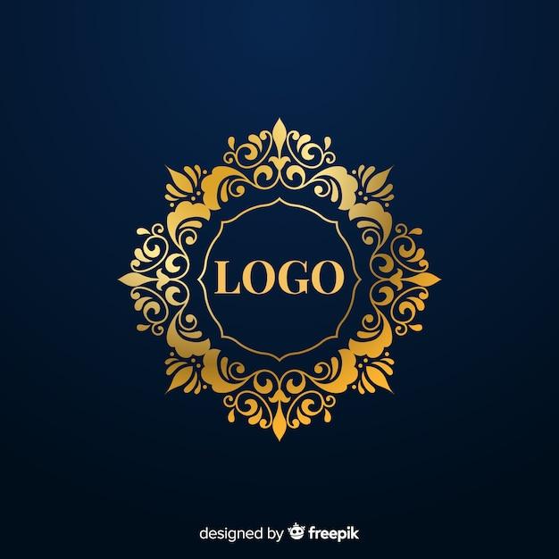 エレガントな黄金の装飾的なロゴ 無料ベクター