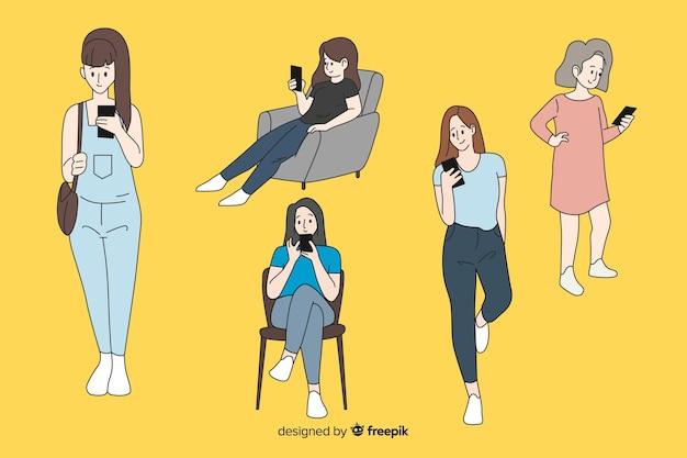 Девушки держат смартфоны в корейском стиле рисования Бесплатные векторы