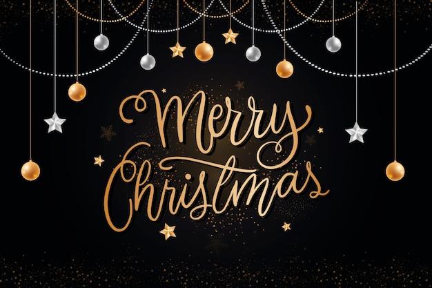 Рождественская надпись с реалистичными элементами Бесплатные векторы