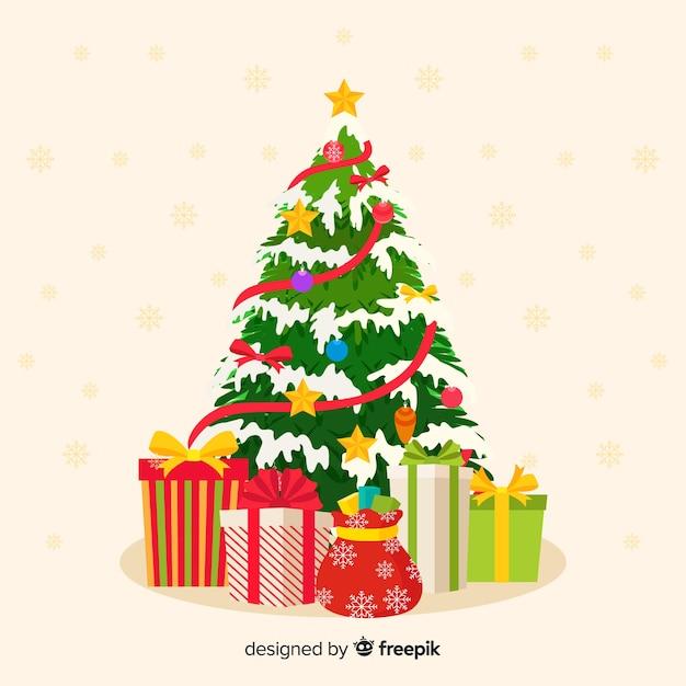 プレゼントとフラットなクリスマスツリー 無料ベクター