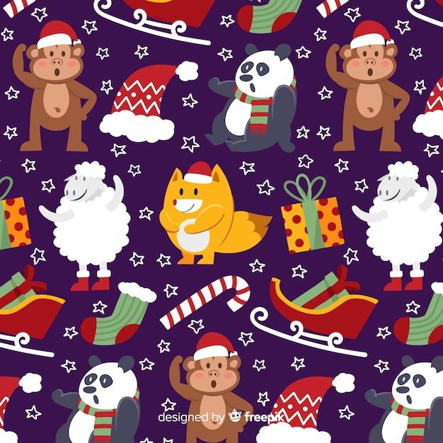 動物とクリスマスの面白いパターン 無料ベクター
