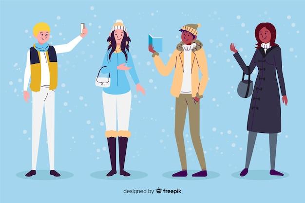 冬服フラットデザインを持つ人々 無料ベクター