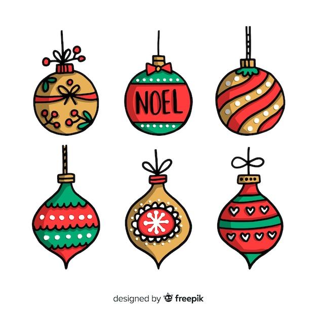 白い背景の上の手描きクリスマスボール 無料ベクター