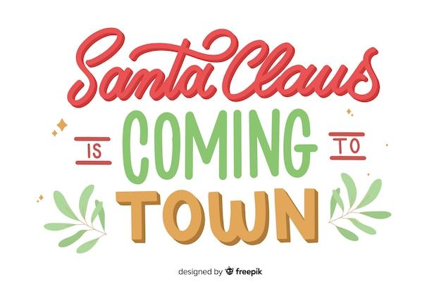 Санта-клаус приходит в город надписи Бесплатные векторы