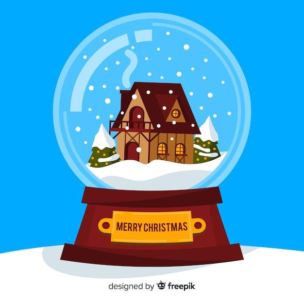 Трясти земной шар снегом и домом Бесплатные векторы