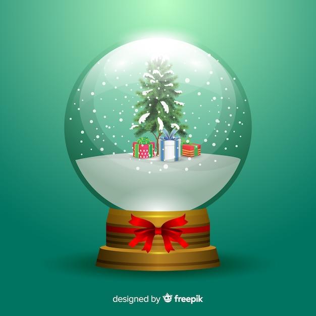 Рождественский снежный шар с подарками Бесплатные векторы