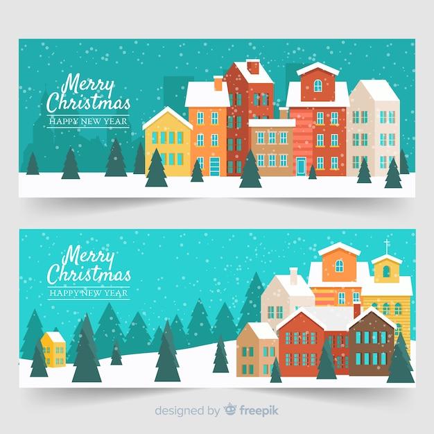 Плоские рождественские снежные городские баннеры Бесплатные векторы