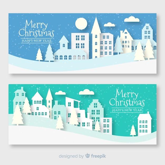 Набор рождественских баннеров города в бумажном стиле Бесплатные векторы