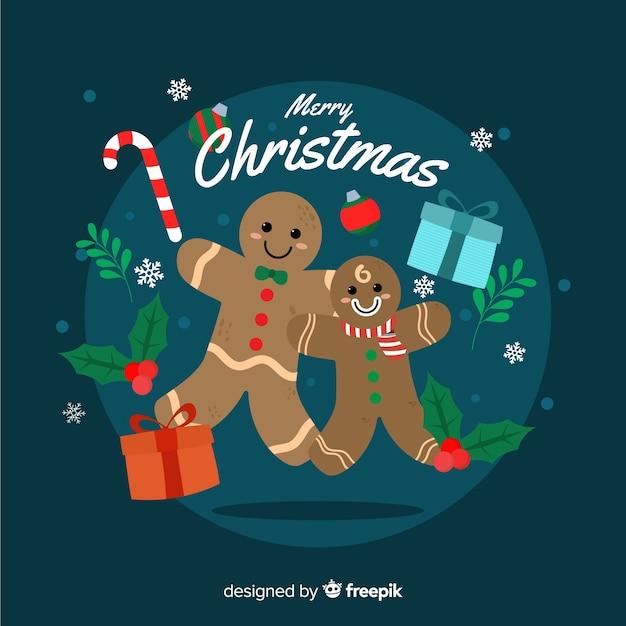 ジンジャーブレッド人とフラットなクリスマス背景 無料ベクター