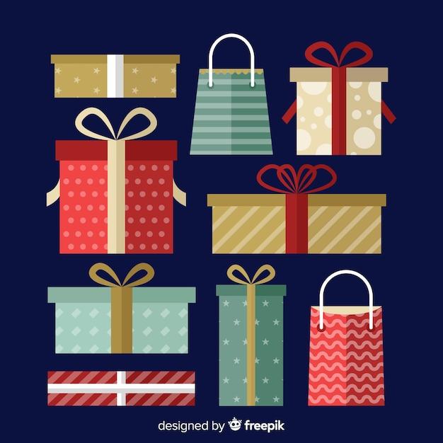 Плоский рождественский подарок на синем фоне Бесплатные векторы