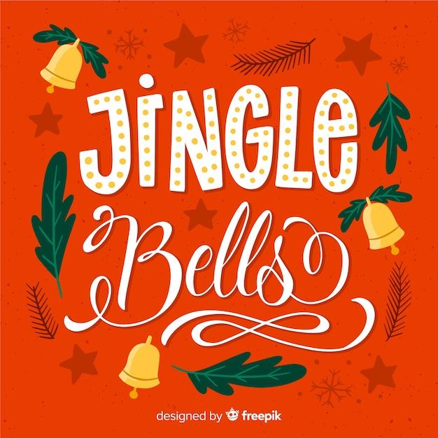 クリスマスのレタリングとオレンジ色の背景 無料ベクター