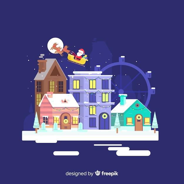 ワンダーホイールとフラットなクリスマスタウン 無料ベクター