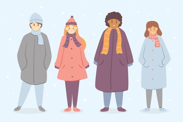 Люди в зимней одежде на синем фоне Бесплатные векторы