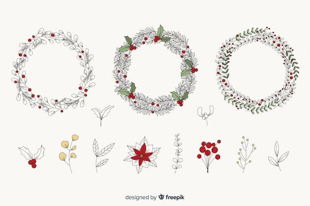 Старинные рождественские цветы и венок Бесплатные векторы