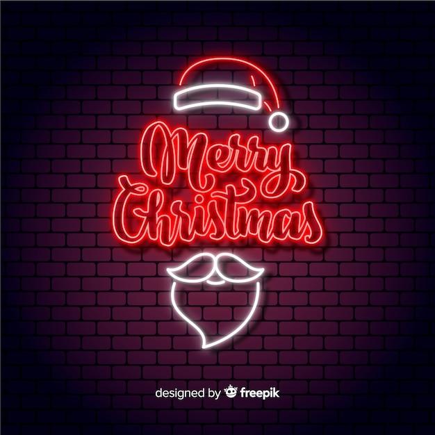 С рождеством христовым концепция с неоновым дизайном Бесплатные векторы