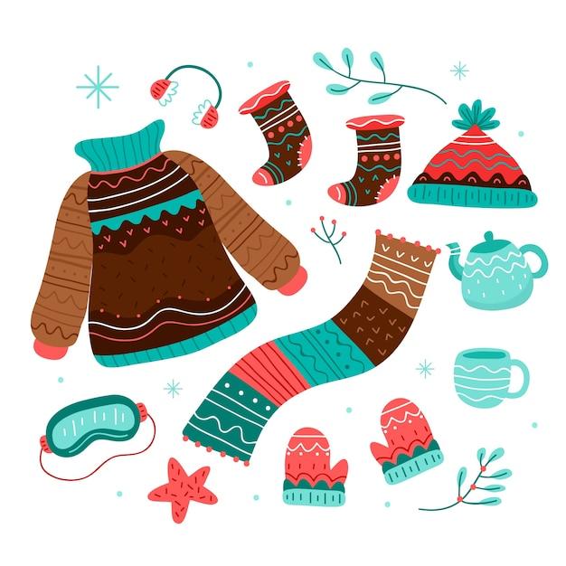 Ручной обращается зимняя одежда и предметы первой необходимости Бесплатные векторы