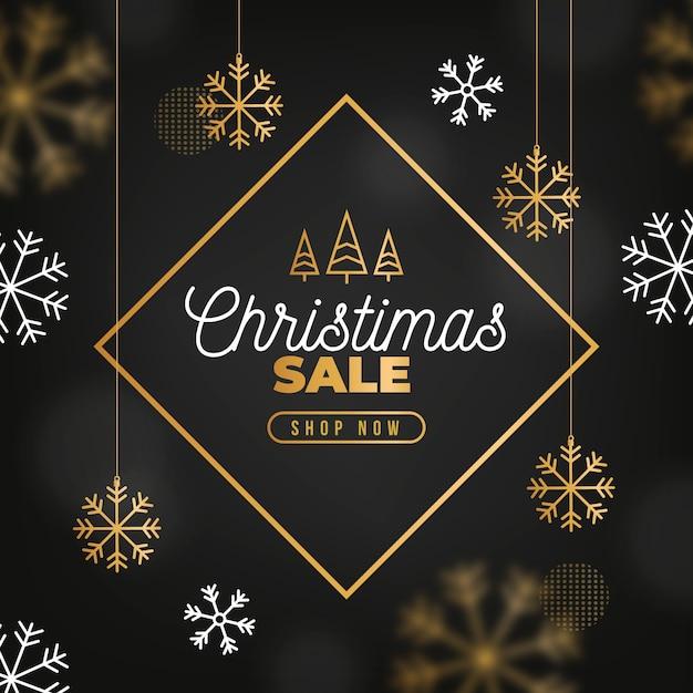 Рождественская распродажа концепции с золотым фоном Бесплатные векторы