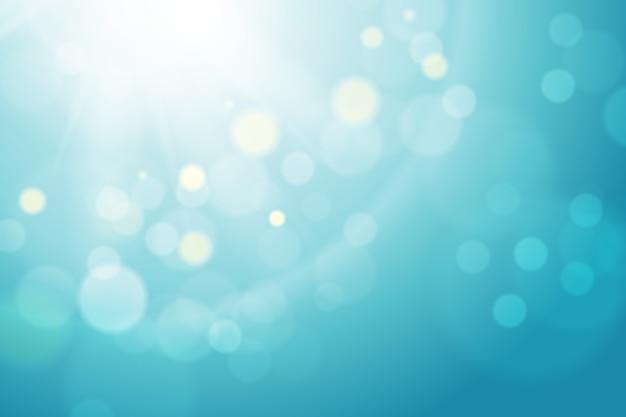 ピンぼけ効果と青のグラデーションの背景 無料ベクター