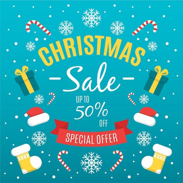 Плоская новогодняя распродажа и подарочные коробки и одежда Бесплатные векторы