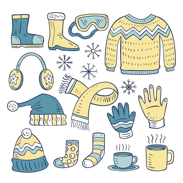 Набор рисованной зимней одежды и предметов первой необходимости Бесплатные векторы