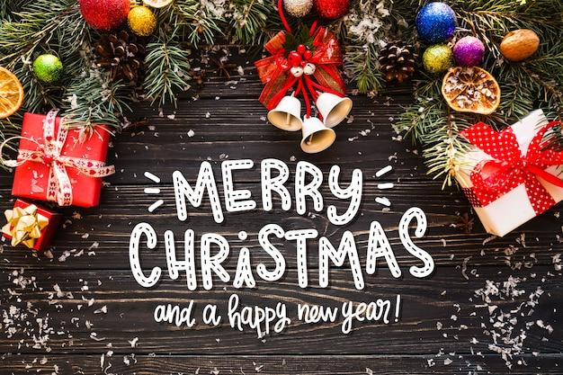 Счастливого рождества надписи на новогодней фотографии Бесплатные векторы