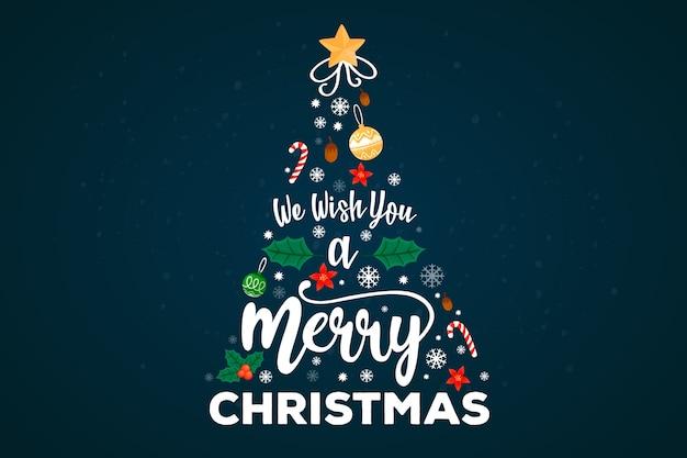 レタリングの装飾とメリークリスマスツリー 無料ベクター