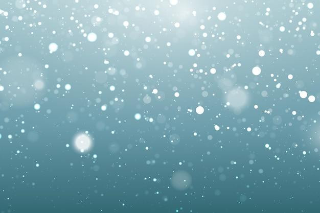 ボケ要素を持つ現実的な降雪の背景 無料ベクター
