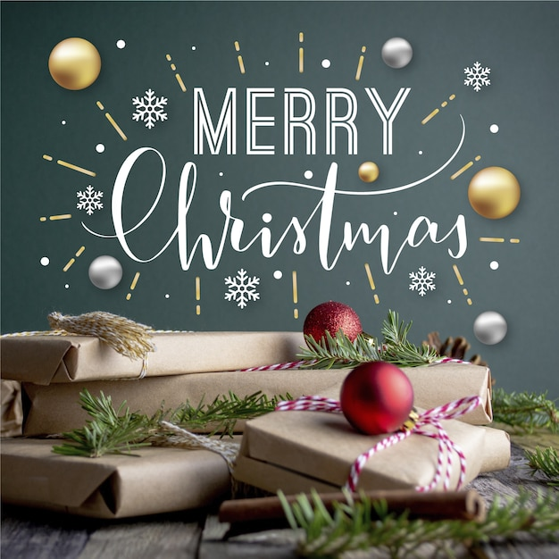 メリークリスマスレタリングプレゼントと地球儀のクリスマス写真 無料ベクター