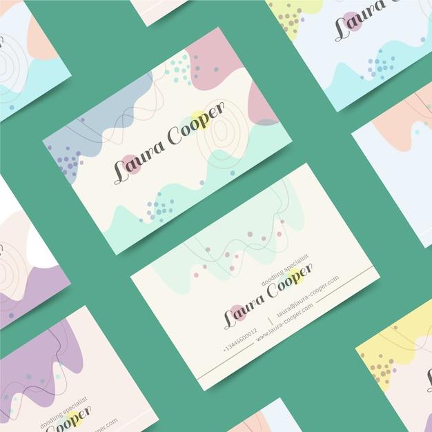 Мемфис визитная карточка с пастельными пятнами Бесплатные векторы