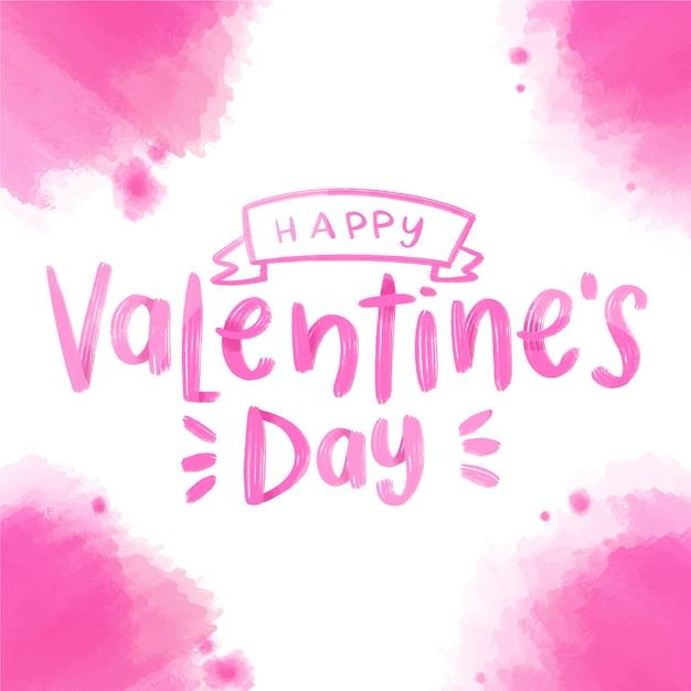 ピンクの水彩汚れと幸せなバレンタインデーのレタリング 無料ベクター