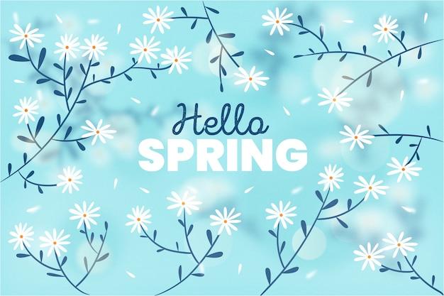 枝と花とぼやけた春の背景 無料ベクター