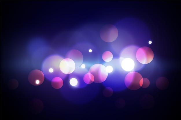 Эффект боке огни на темную тему обоев Бесплатные векторы